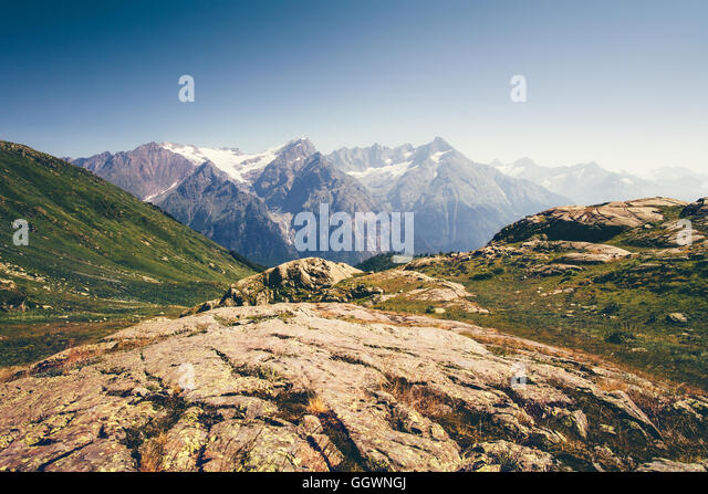 Rocky Mountains Landscape in Abkhazia with blue sky Summer Travel serene scenic view of Greater Caucasus Range - Stock Image