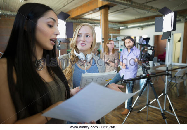 Creative businesswoman preparing to film tutorial - Stock Image
