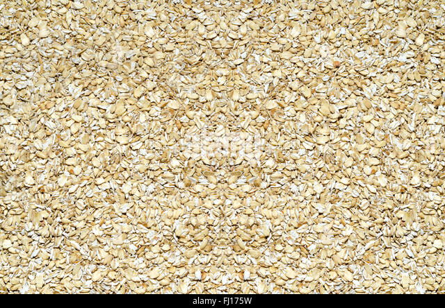 Background of oats rassypannoj on the surface - Stock Image