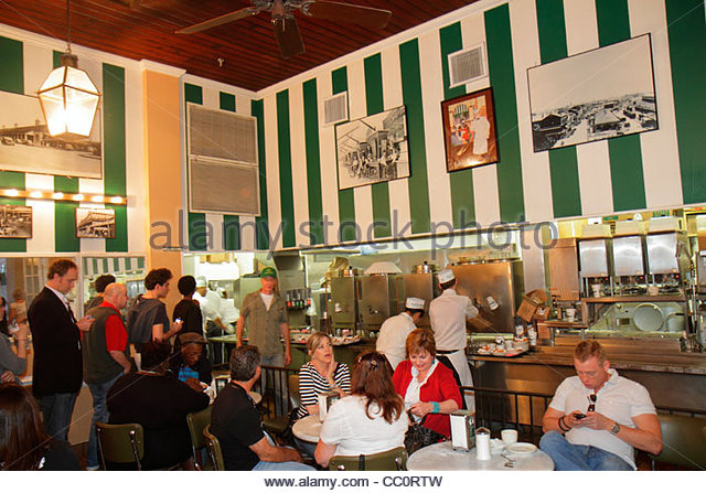 New Orleans Louisiana French Quarter historic district Decatur Street Cafe du Monde coffee shop stand business café - Stock Image