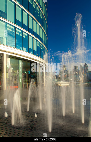 Water fountains near City Hall and the 'More London' development on the south bank of the River Thames, - Stock Image