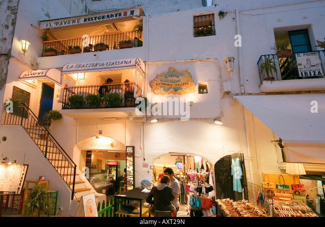 Spain Baleares island Ibiza town by night shops restaurants - Stock Image
