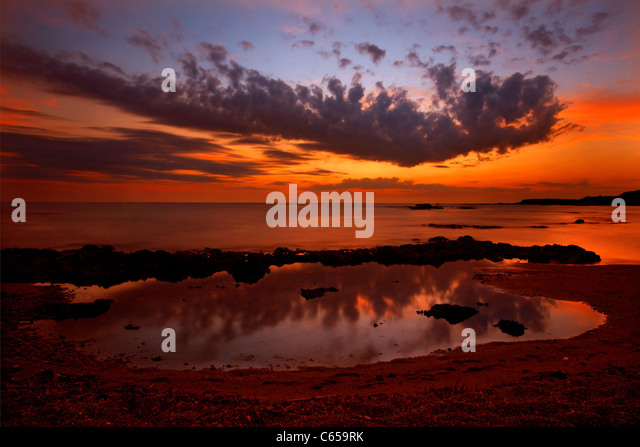 Sunset at the Ionian sea, at the beach close to Pantokratoras castle, Preveza, Epirus, Greece - Stock Image