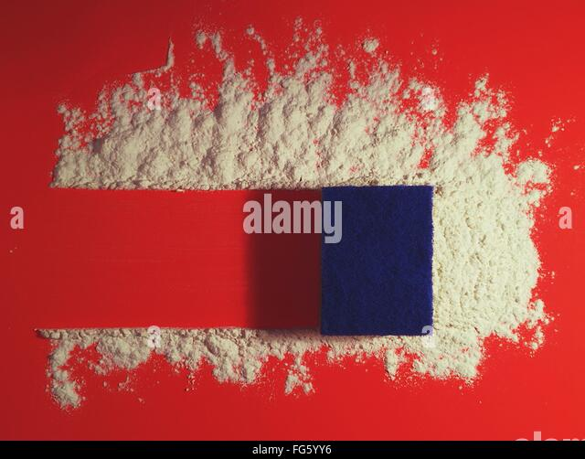 High Angle View Of Sponge Cleaning Powder On Red Table - Stock Image