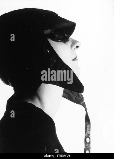 Side View Of Young Woman Wearing Aviator Cap And Sunglasses - Stock Image