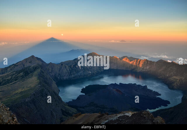 Indonesia, West Nusa Tenggara, View of Mt. Rinjani with Segare Anak Lake on background - Stock Image