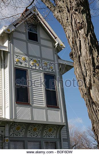 Marquette Michigan Upper Peninsula U.P. UP Lake Superior Ridge Street house home trim ornamental design window tree - Stock Image