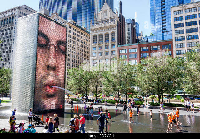 Illinois Chicago Loop Millennium Park Crown Fountain reflecting pool North Michigan Avenue city skyline skyscrapers - Stock Image