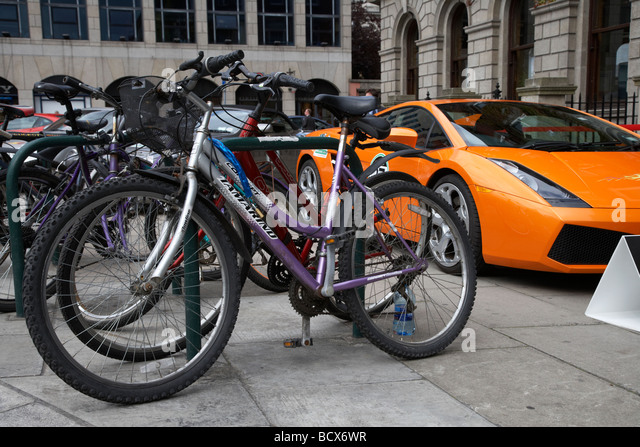 lamborghini sports car parked on pavement beside row of bicycles dublin republic of ireland - Stock Image