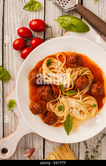 Pasta with meatballs with fresh basil and tomato sauce - Stock Image