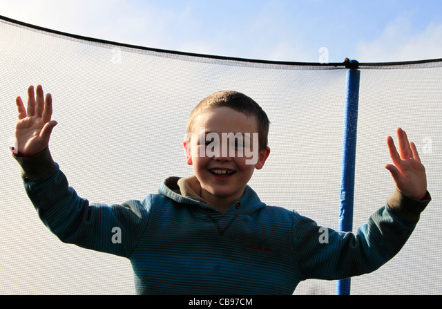 Young boy on trampoline - Stock Image