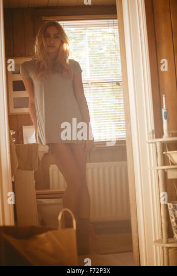 Pretty woman relaxing at home - Stock Image