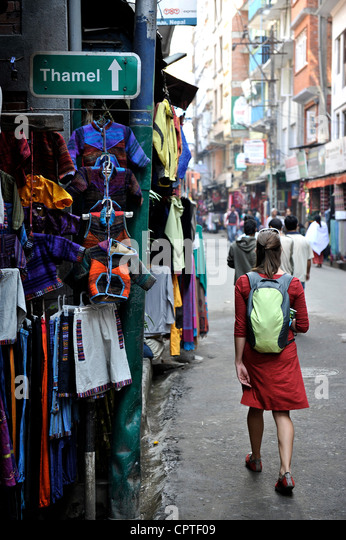 Woman tourist walks down the street of Thamel in Kathmandu, Nepal - Stock-Bilder