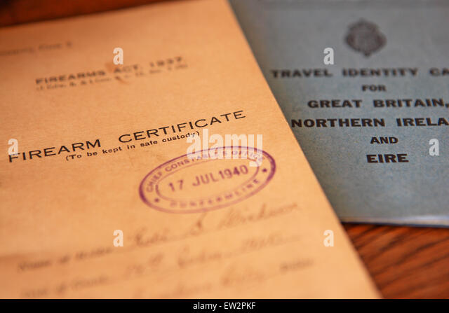 UK Firearm certificate and travel identity card from the 1940's - Stock-Bilder