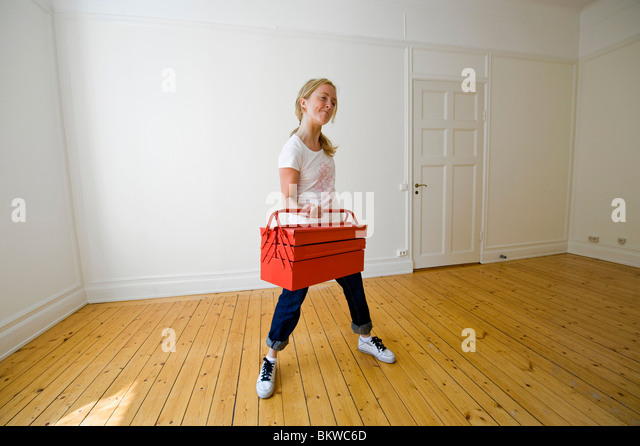 Woman working out with toolbox - Stock Image