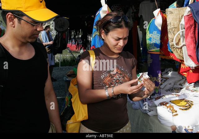 BVI Tortola Tent Village Road Town Cruise Port Asian couple shopping - Stock Image