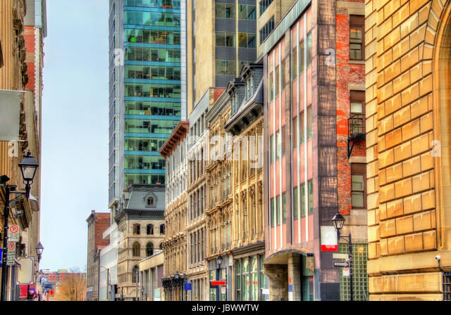 Buildings on Notre-Dame street in Old Montreal, Canada - Stock Image