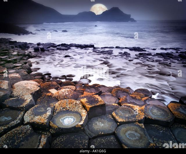 GB - NORTHERN IRELAND:  Moon over Giant's Causeway - Stock-Bilder
