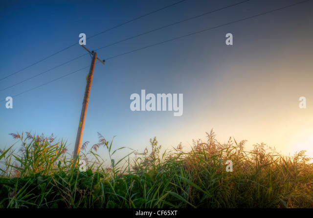 Bright sunrise in the wide, open skies of the Cambridgeshire Fens. - Stock Image