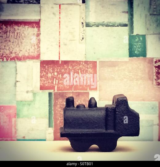 Little journeys, tiny locomotive on abstract background - Stock Image