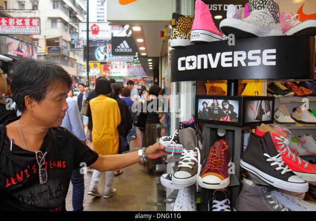 Hong Kong China Kowloon Mong Kok Fa Yuen Street Sneaker Street shopping fashion athletic shoe store Converse promotion - Stock Image
