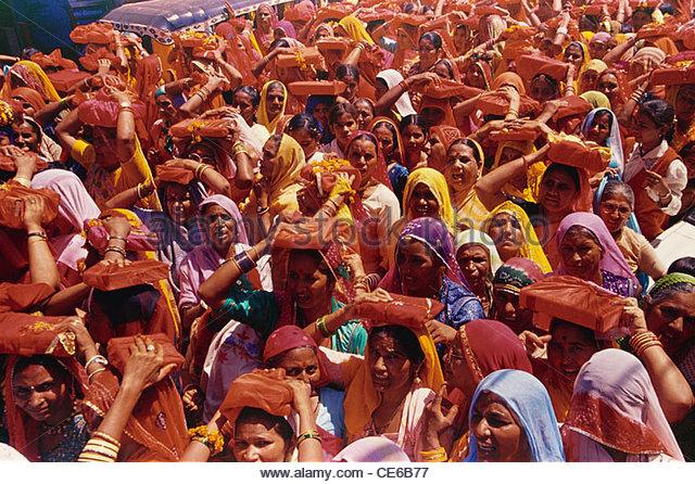 women carrying bhagwat geeta Bhagavad gita on head in a religious procession ; Jodhpur ; Rajasthan ; India - Stock Image