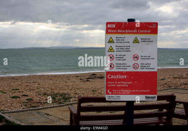 Warning sign at West Beachlands on Hayling Island in Hampshire - Stock Image
