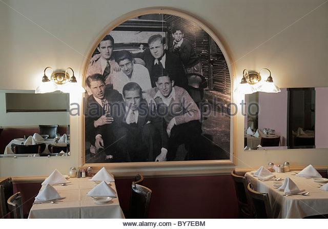 Maryland Baltimore Little Italy ethnic neighborhood business restaurant Sabatino's Italian cuisine dining mural - Stock Image