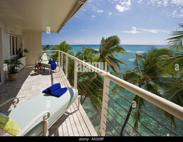 House balcony chairs stock photos house balcony chairs for Balcony overlooking ocean