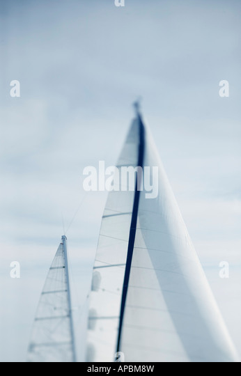 sailboat under sail  in calm seas and light wind sailing cruising yacht vertical  trip journey travel holiday vacation - Stock-Bilder