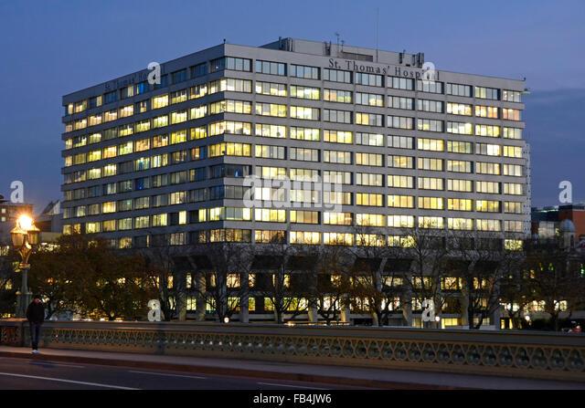 St Thomas Hospital London seen from Westminster Bridge at dusk England UK - Stock Image