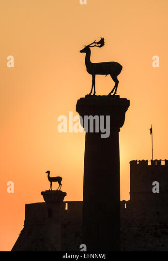 sunrise in Mandraki harbor. Rhodes, Greece - Stock Image