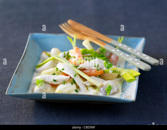 Chicken and vegetable Nage - Stock Image