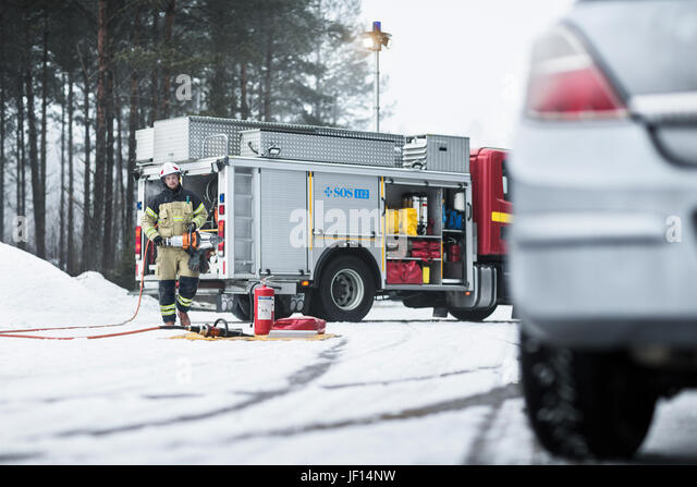 Firefighter on road - Stock Image