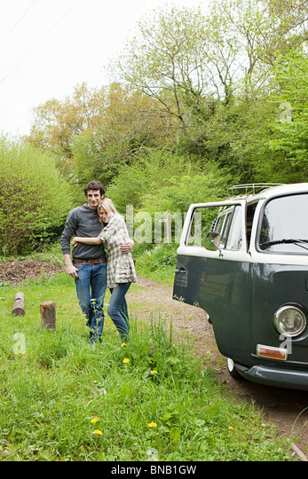 Young couple by camper van - Stock Image