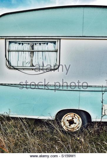 An old abandoned vintage caravan - Stock-Bilder