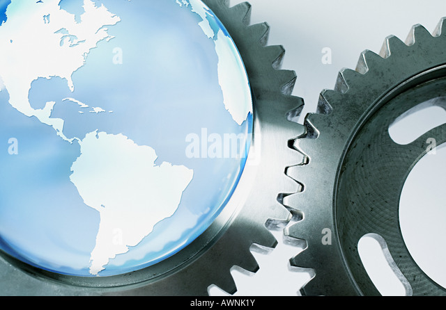 Planet earth and machine cogs - Stock Image