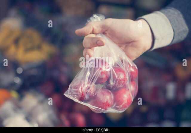 Hands selecting fruit - Stock Image