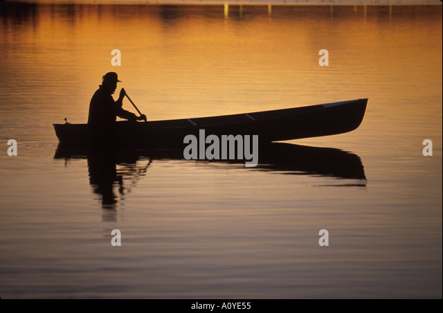 Man Canoeing Sunset in Lake Southcentral AK - Stock Image