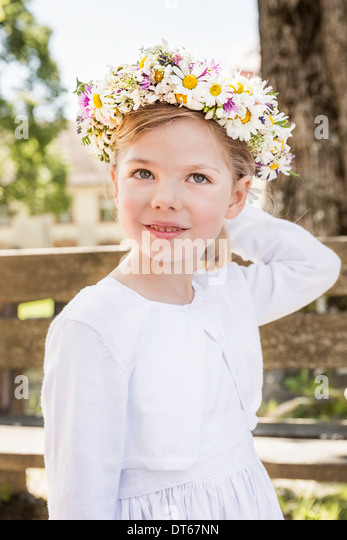 Portrait of young bridesmaid with floral headdress - Stock Image