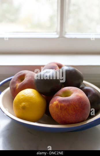 Still life fruit in a bowl by window - Stock Image