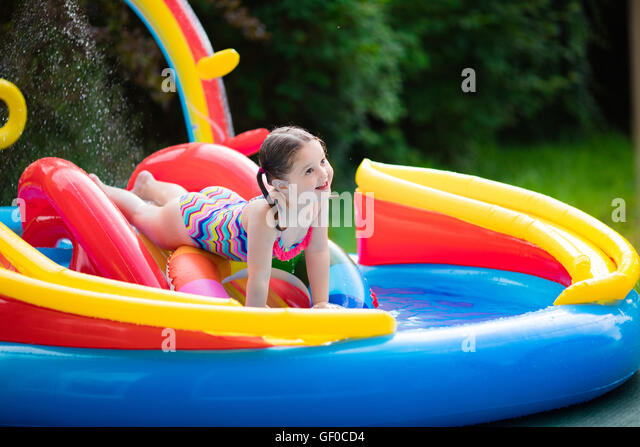 Kids playing in backyard swimming stock photos kids for Children s garden pools