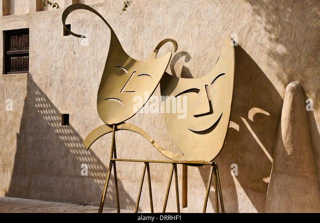 Comedy and Tragedy sculpture outside theatre in Bastakia Quarter of Old Dubai, UAE - Stock Image
