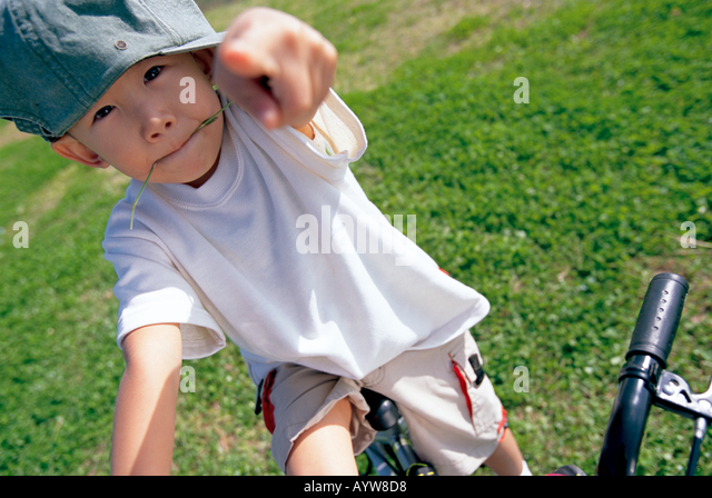 Boy on a bicycle - Stock-Bilder