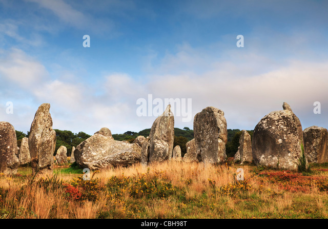 Some of the 3000 prehistoric megaliths at Carnac, Brittany, France, on a sunny autumn evening. - Stock Image