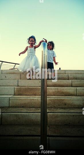 Kids Walking Down Stairs - Stock Image