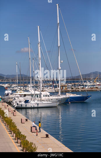Luxury yachts in the port of Alghero in the province of Sassari on the northwest coast of the island of Sardinia, - Stock Image