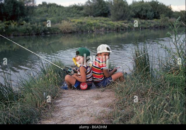 Taking kids fishing stock photos taking kids fishing for Pecos new mexico fishing