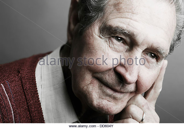 Senior man looking away, close up - Stock Image