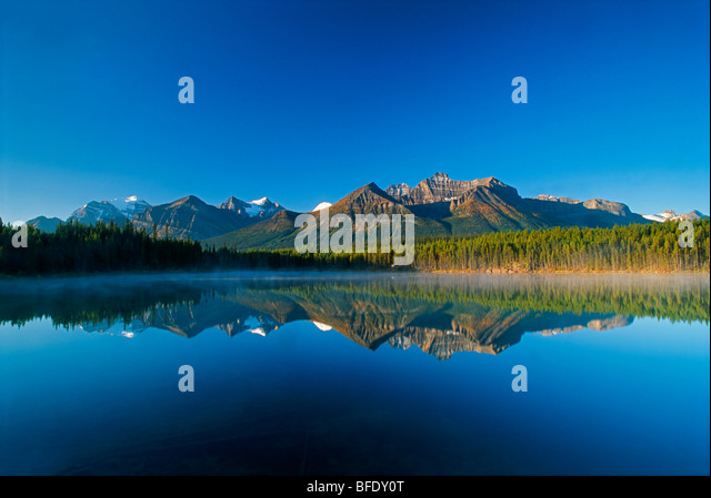 Mountain reflection in Herbert Lake, Banff National Park, Alberta, Canada - Stock Image